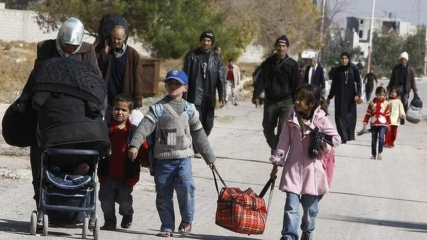Syrians flee Moadamiya once the regime temporarily breaks the siege and allows people to leave the town