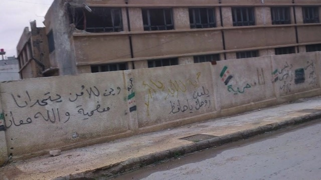 "On a wall in Moadamiya: ""Where is the [regime] security service to challange us? This is Moadamiya, and God is with us."""