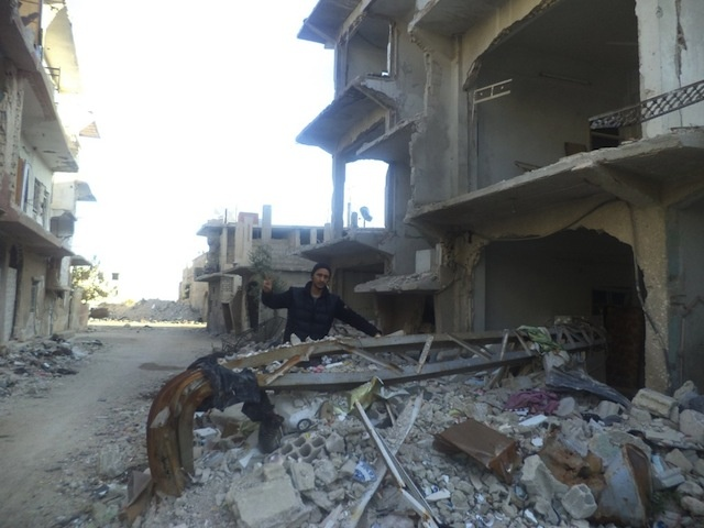 Qusai on the streets of Moadamiya, which has been attacked nearly daily by the regime by shelling and aircraft bombings